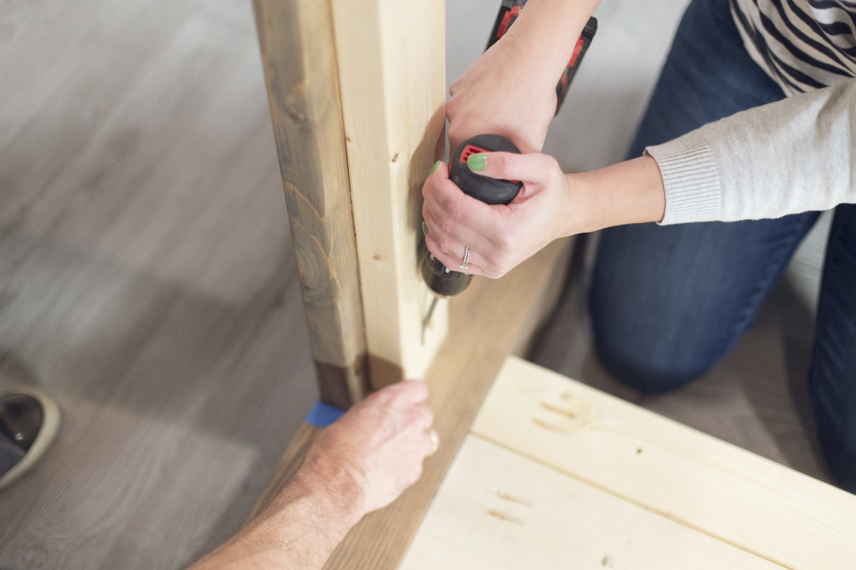 attaching long skirt to bed frame with drill