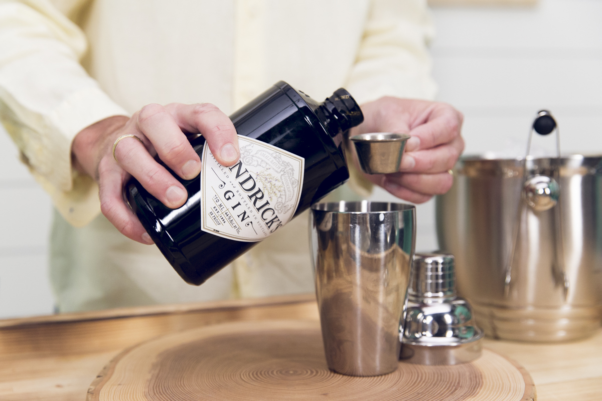pouring hendrick's gin into bar measure