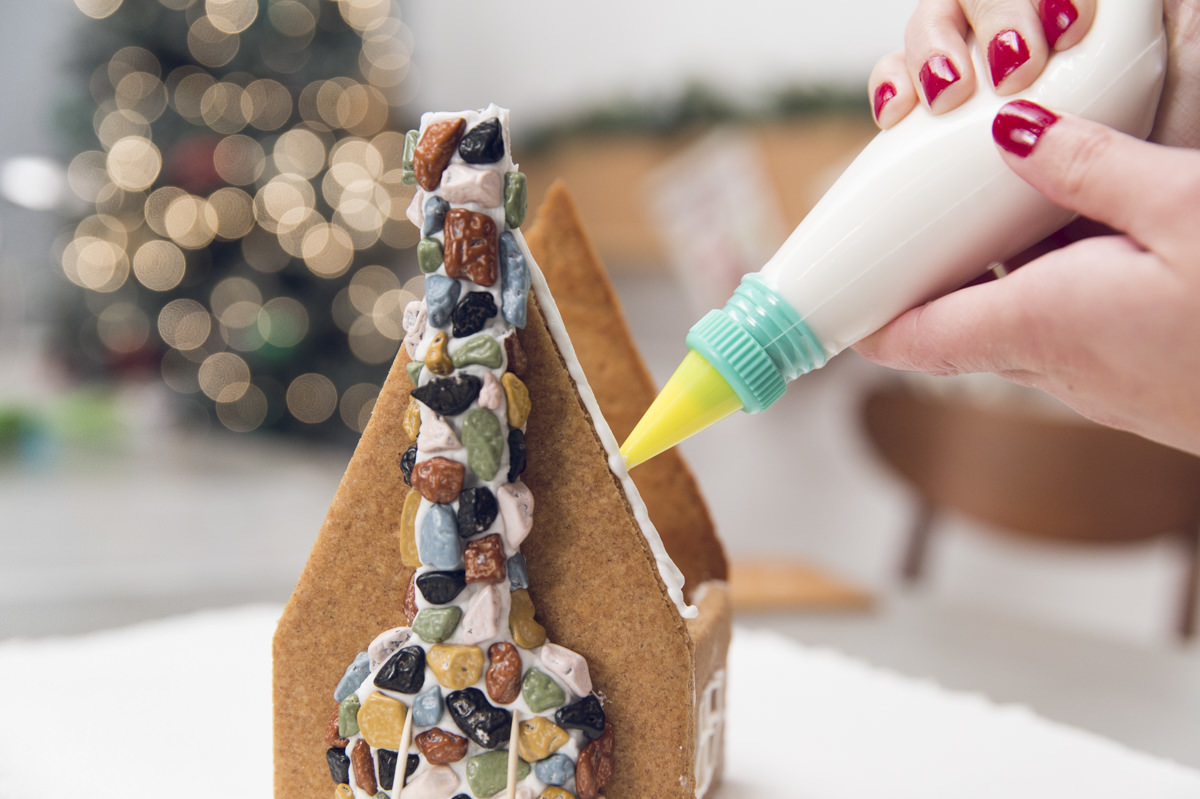 gluing roof on gingerbread house