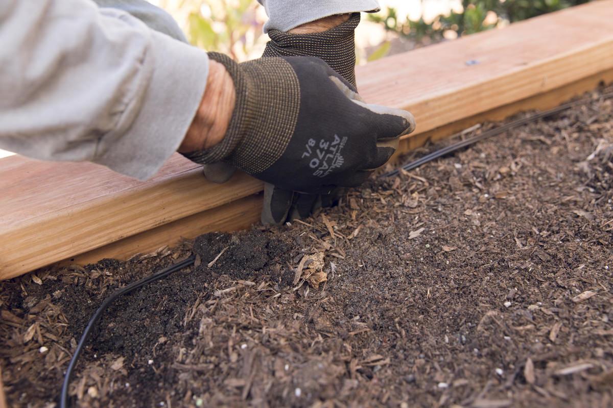 burying wire in raised planter