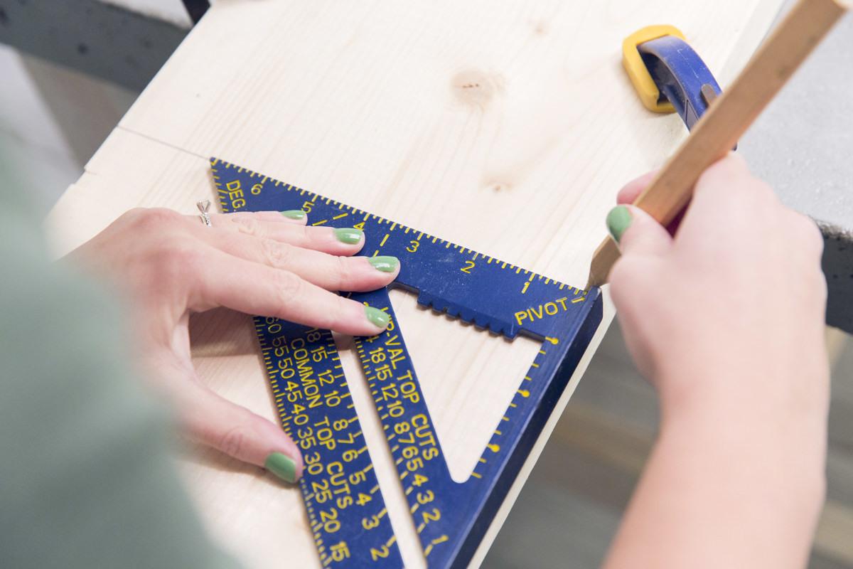 measuring to cut wood board