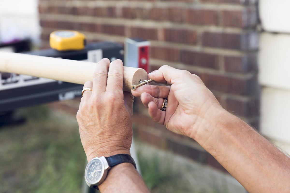 tightening screw on wood pole