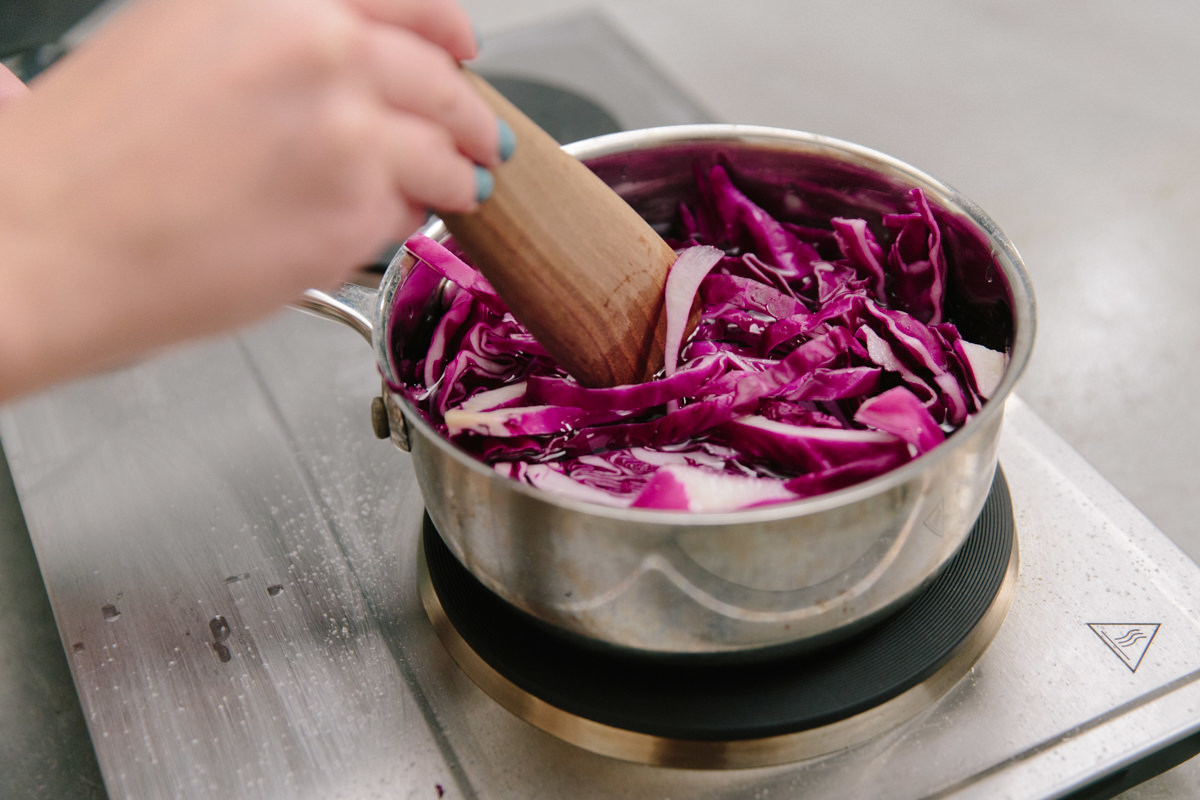stirring red cabbage in pot