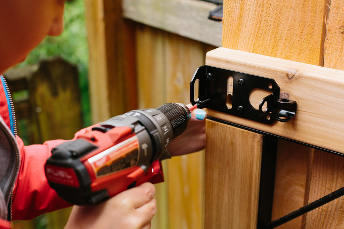 screwing in replacement fence gate latch