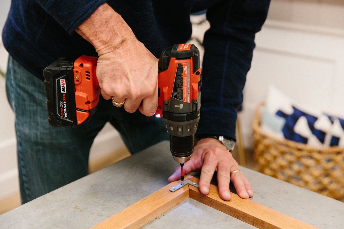 use a drill to secure the corner braces