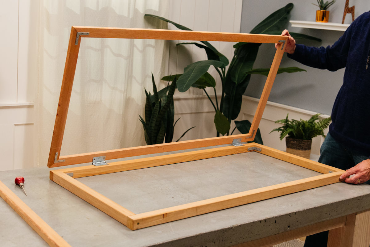 attach privacy panel frame to base frame