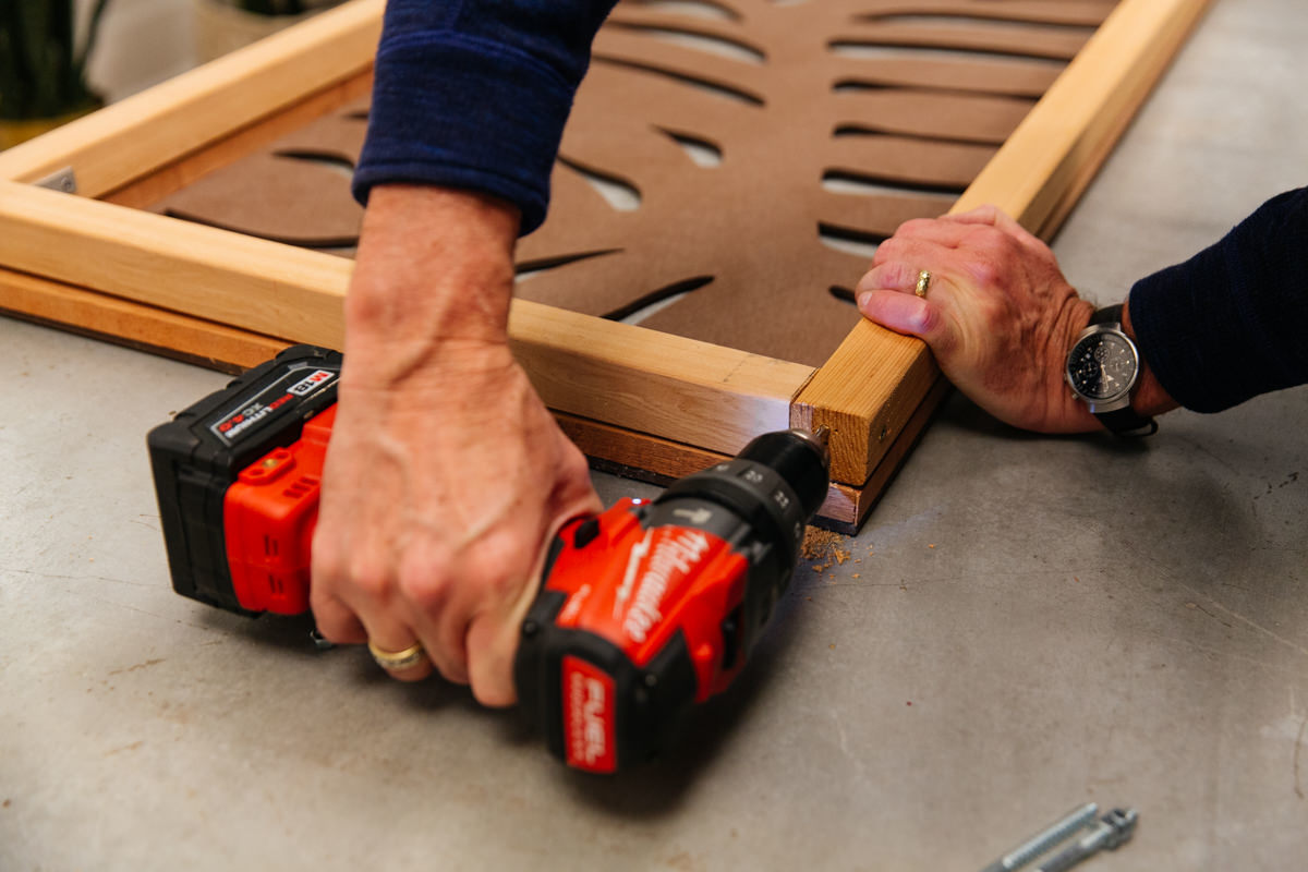 drill the screws in for a stand up privacy panel