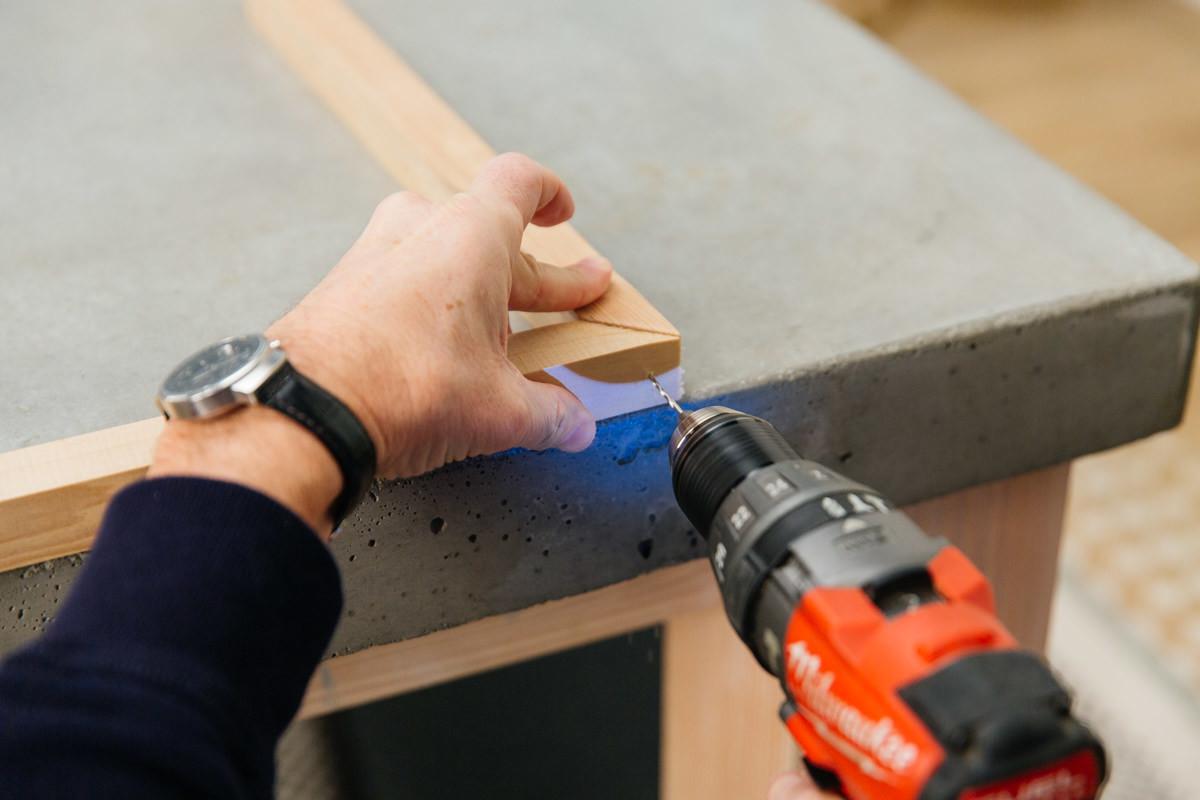 pre-drill a hole at each corner
