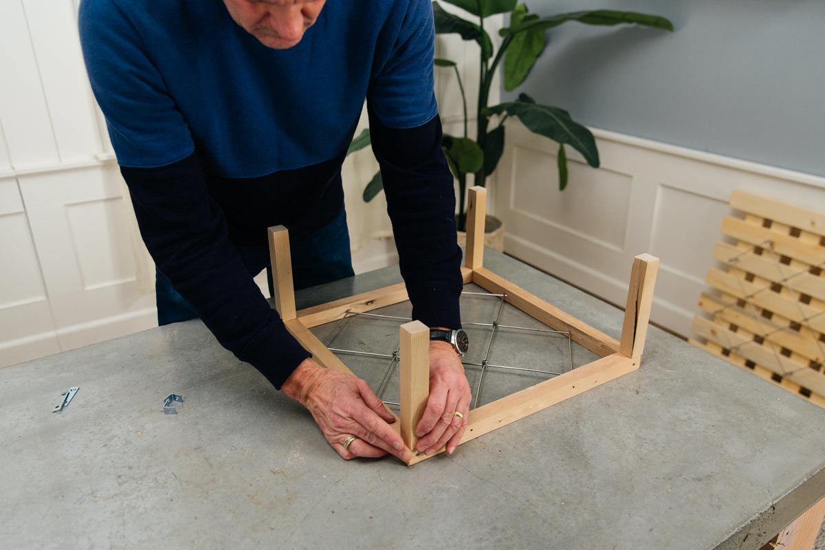 attach legs to frame