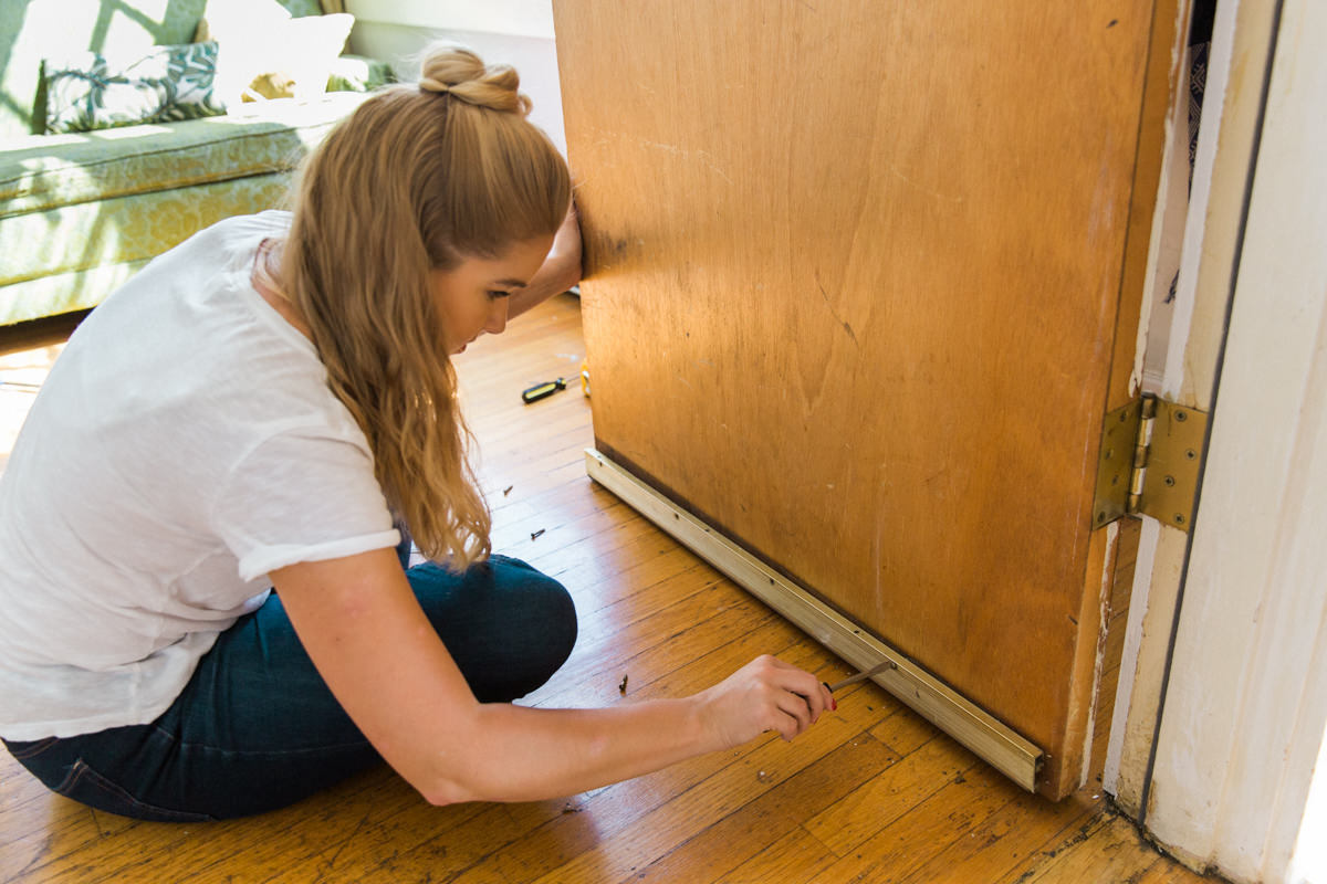 Remove old door bottom to prevent drafts