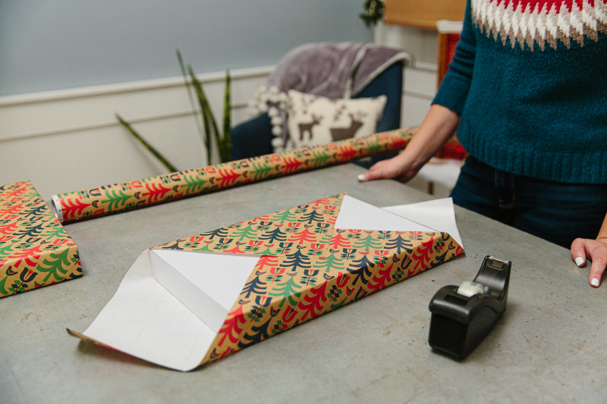 Wrapping a gift with double-sided tape