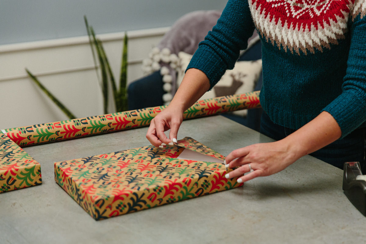 Pull the point of the wrapping paper up