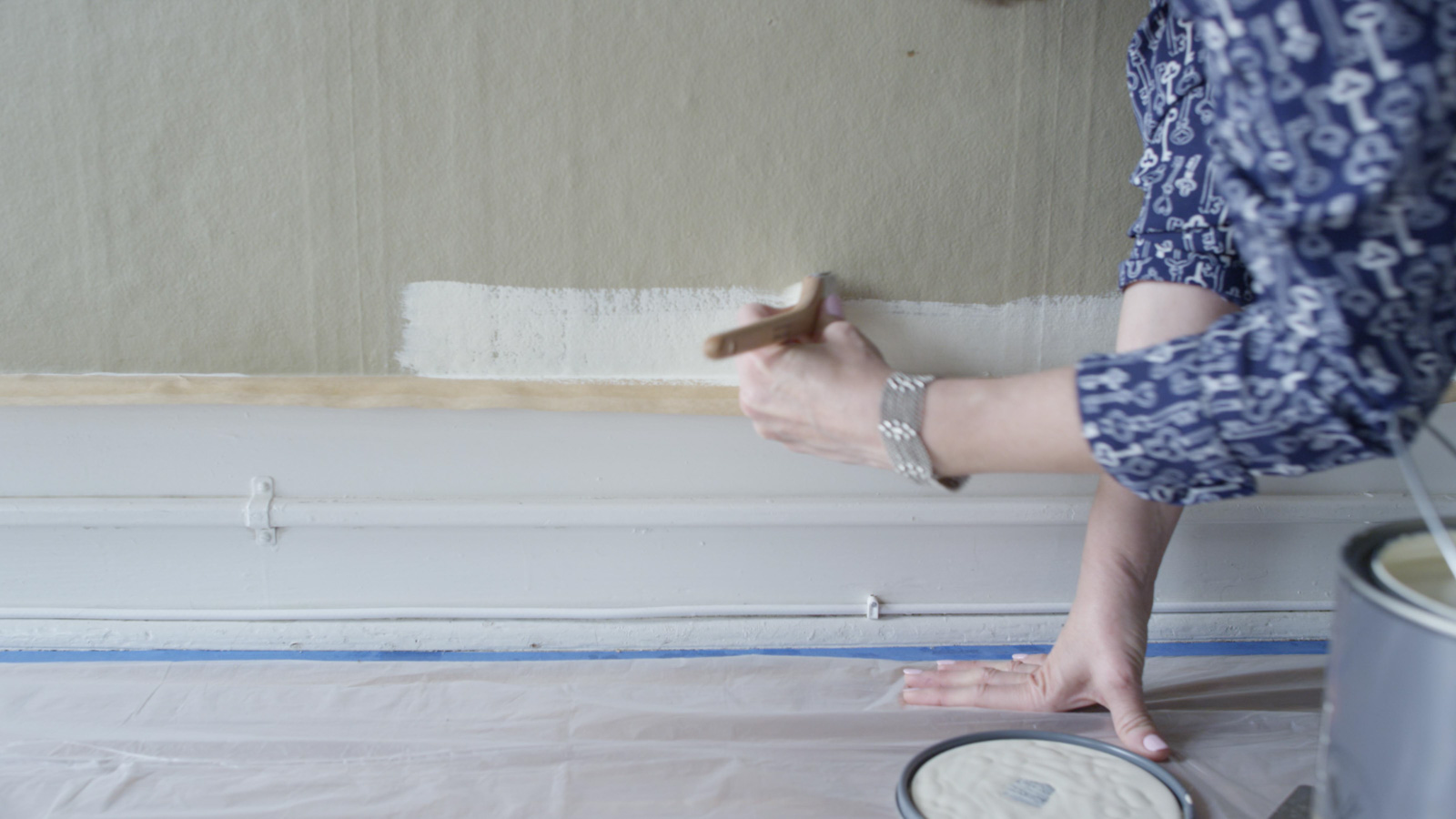 using paintbrush on wall