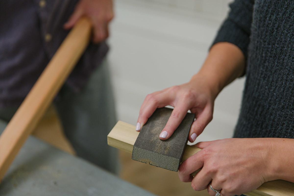 use sandpaper, a sanding sponge, or an electric sander