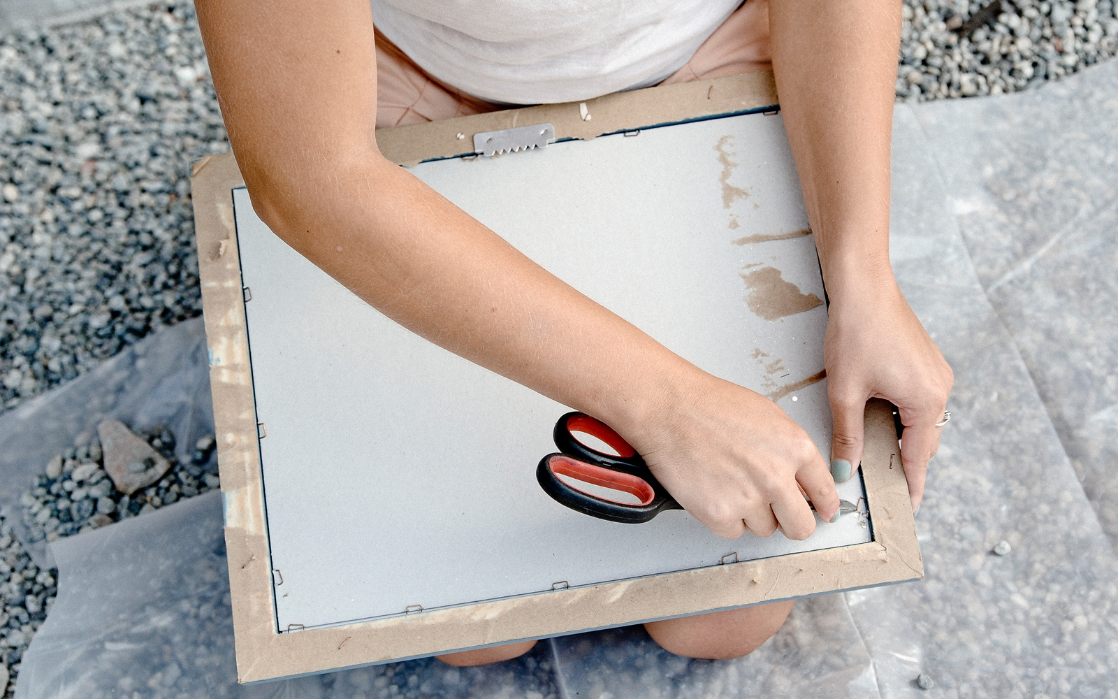 preparing picture frame for dry erase board