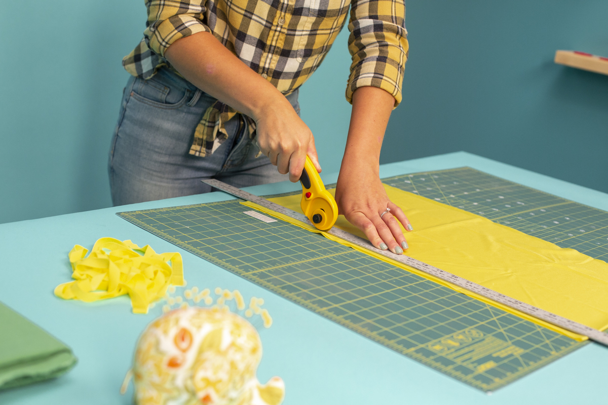 cutting yellow felt with rotary cutter