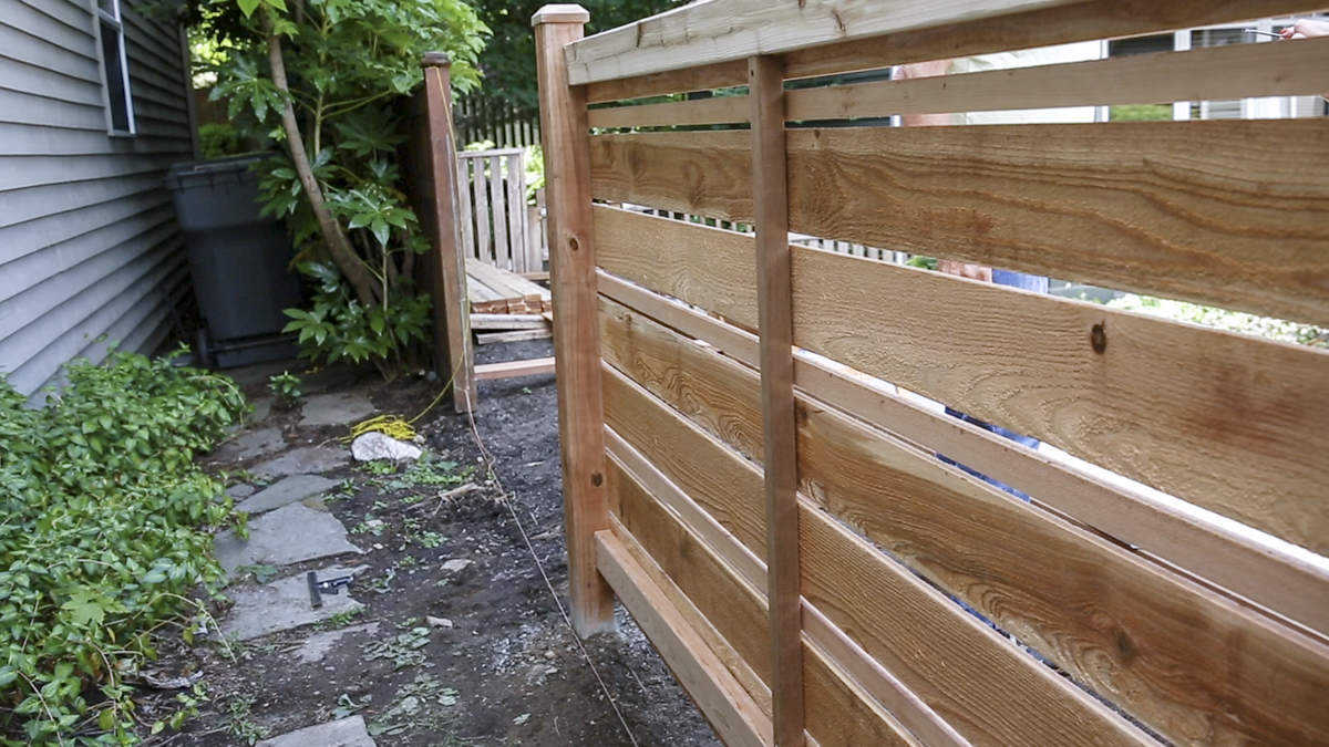 adding vertical board to fence