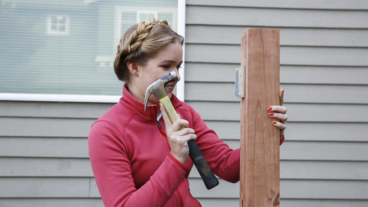 hammering fence post