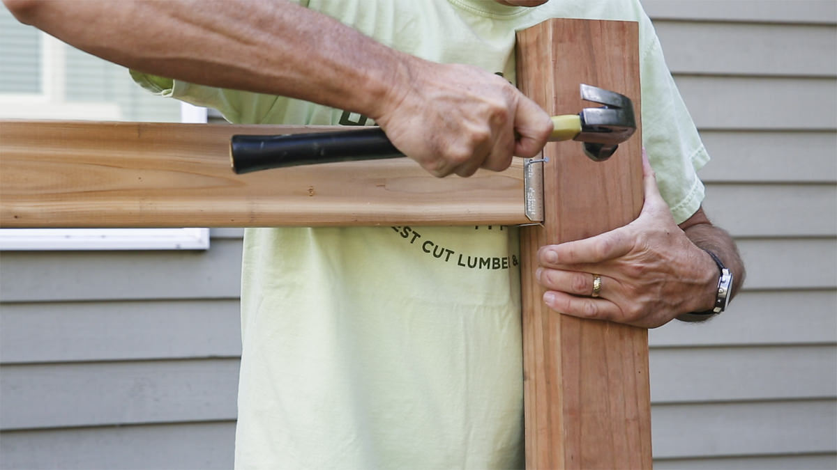 hammering vertical fence post