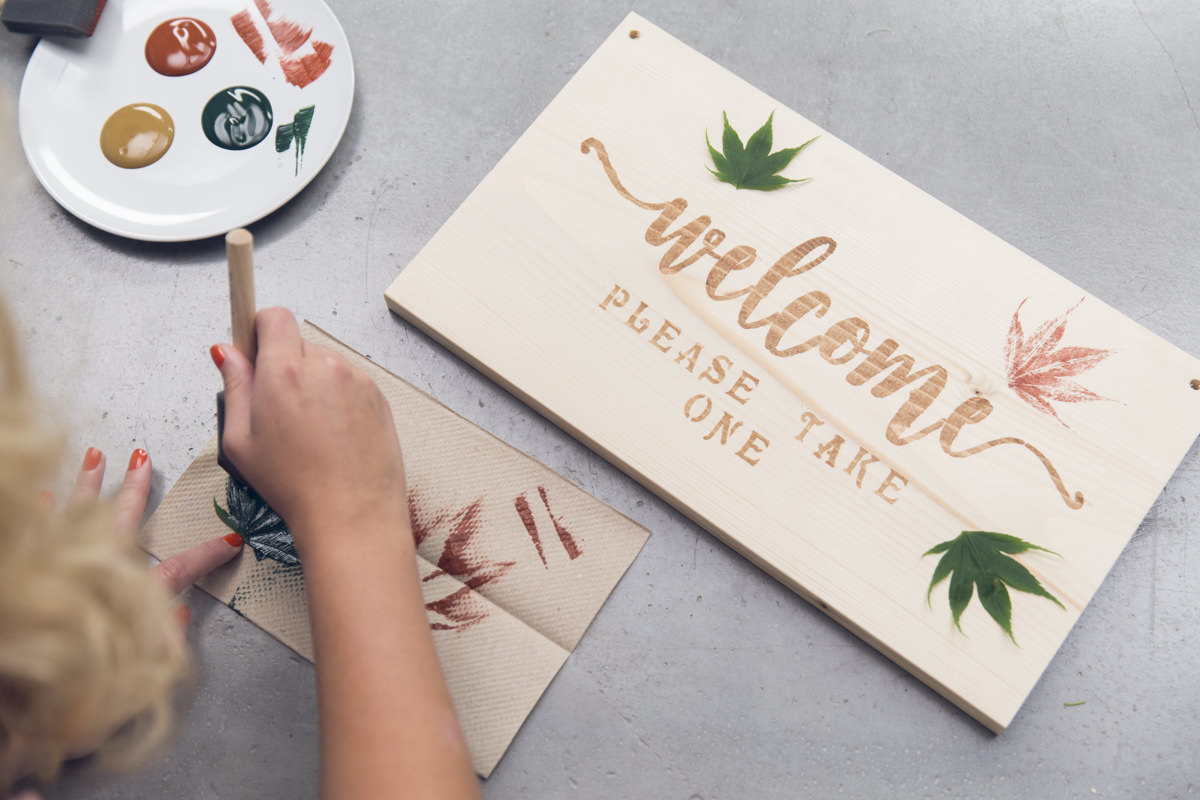painting leaves on diy sign