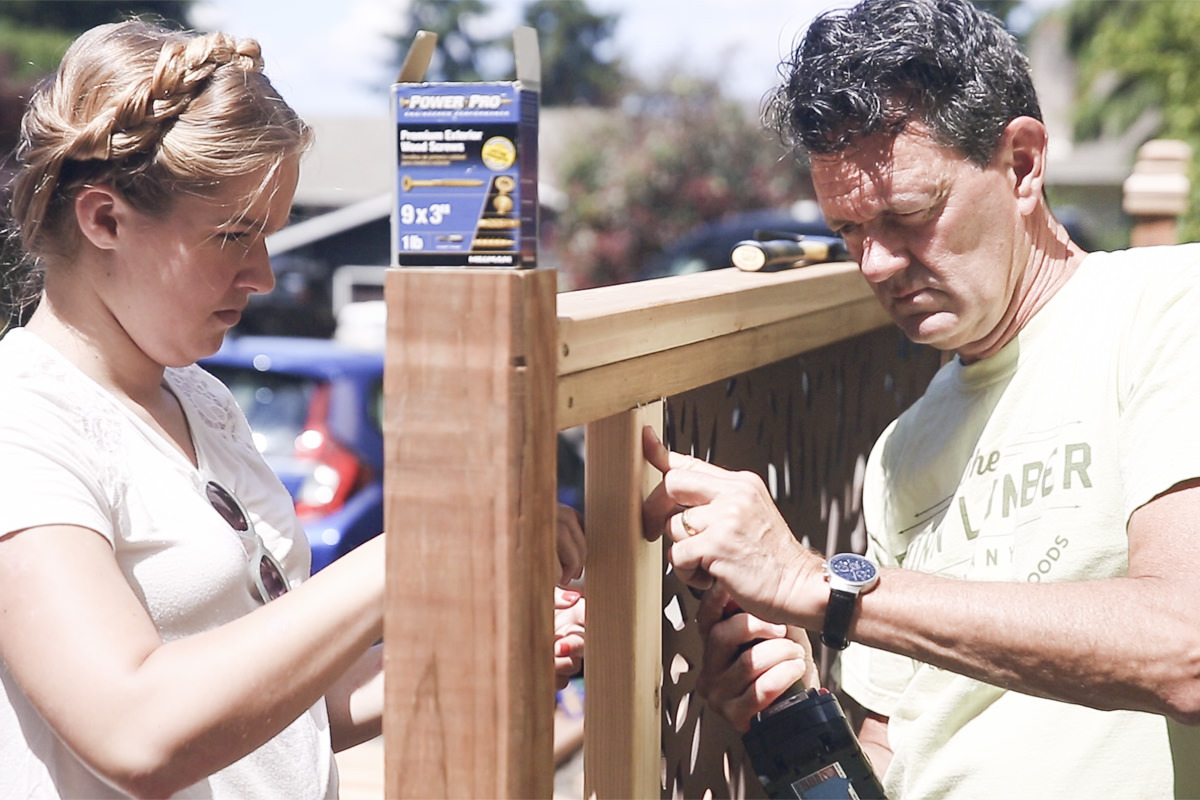attaching vertical framing pieces on fence