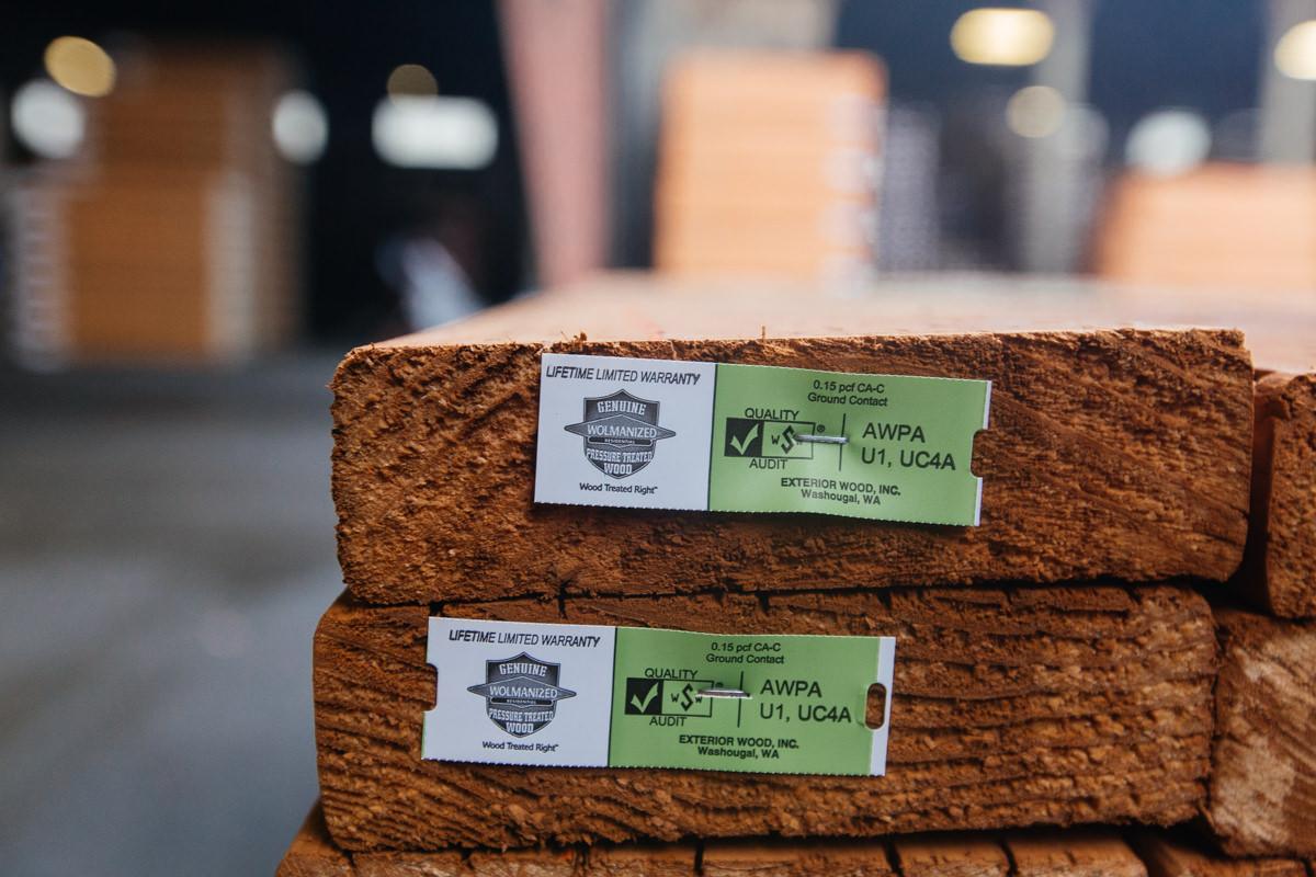 Premium-grade, pressure-treated framing lumber