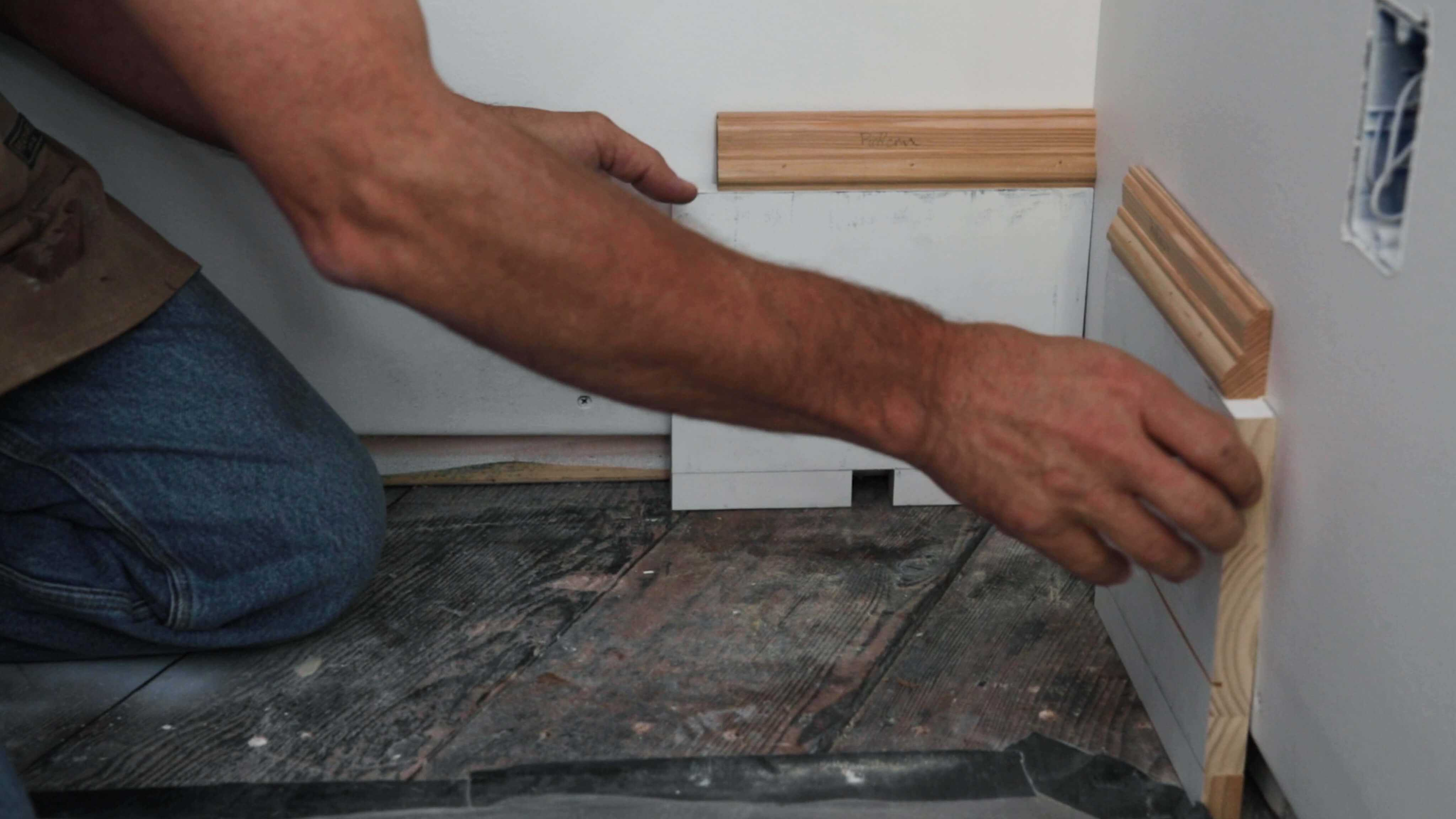 how to use screws as an adjustable shim to fit baseboard corner joints
