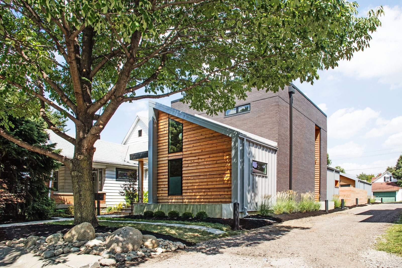 tucked into the of fletcher place in indiana the shoemaker residence succeeds in integrating its modern exterior