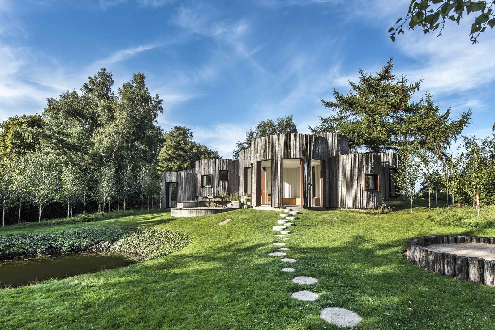Stay in This Danish Vacation Home Made Up of 9 Log-Clad Cylinders
