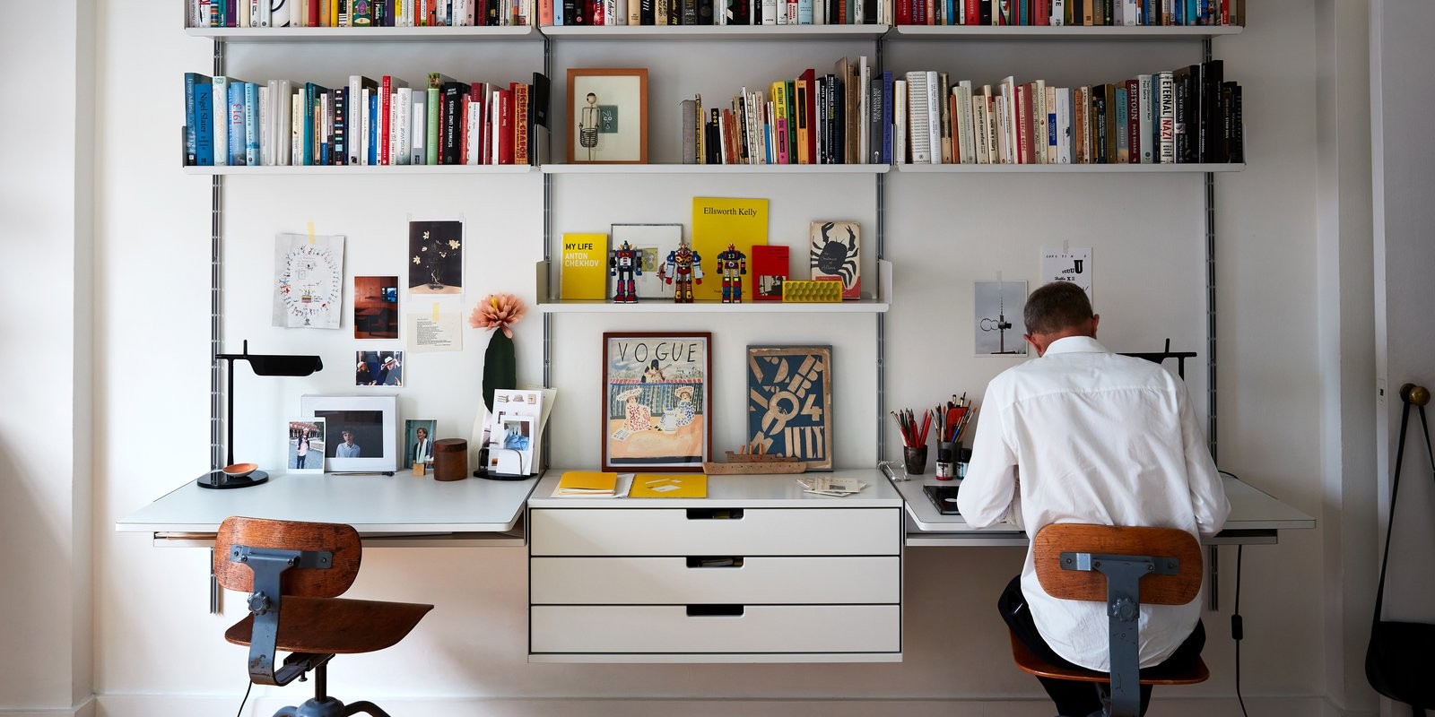 Two Magazine Creatives Fit Graphic Art and Vintage Furniture In a Brooklyn Apartment