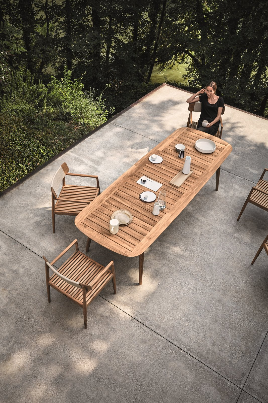 Inspired by teak decking, and echoing the craftsmanship and design of the Tea Clippers that opened trade routes around the world, Pedersen clearly references his inspiration, using generous deck-like slats, finely tapered legs that hint at a ship's mast—even giving the table a hull-like edge. The Clipper collection is simultaneously a nod to a nautical past, as well as a new take on al fresco dining.