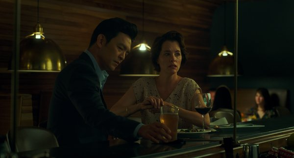 Jin (John Cho) shares a drink with his father's assistant Eleanor (Parker Posey) upon his arrival in Columbus.