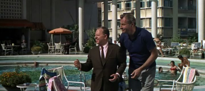 Mickey Rooney and Lex Barker poolside at the Phoenicia Hotel in <em>24 Hours to Kill</em>