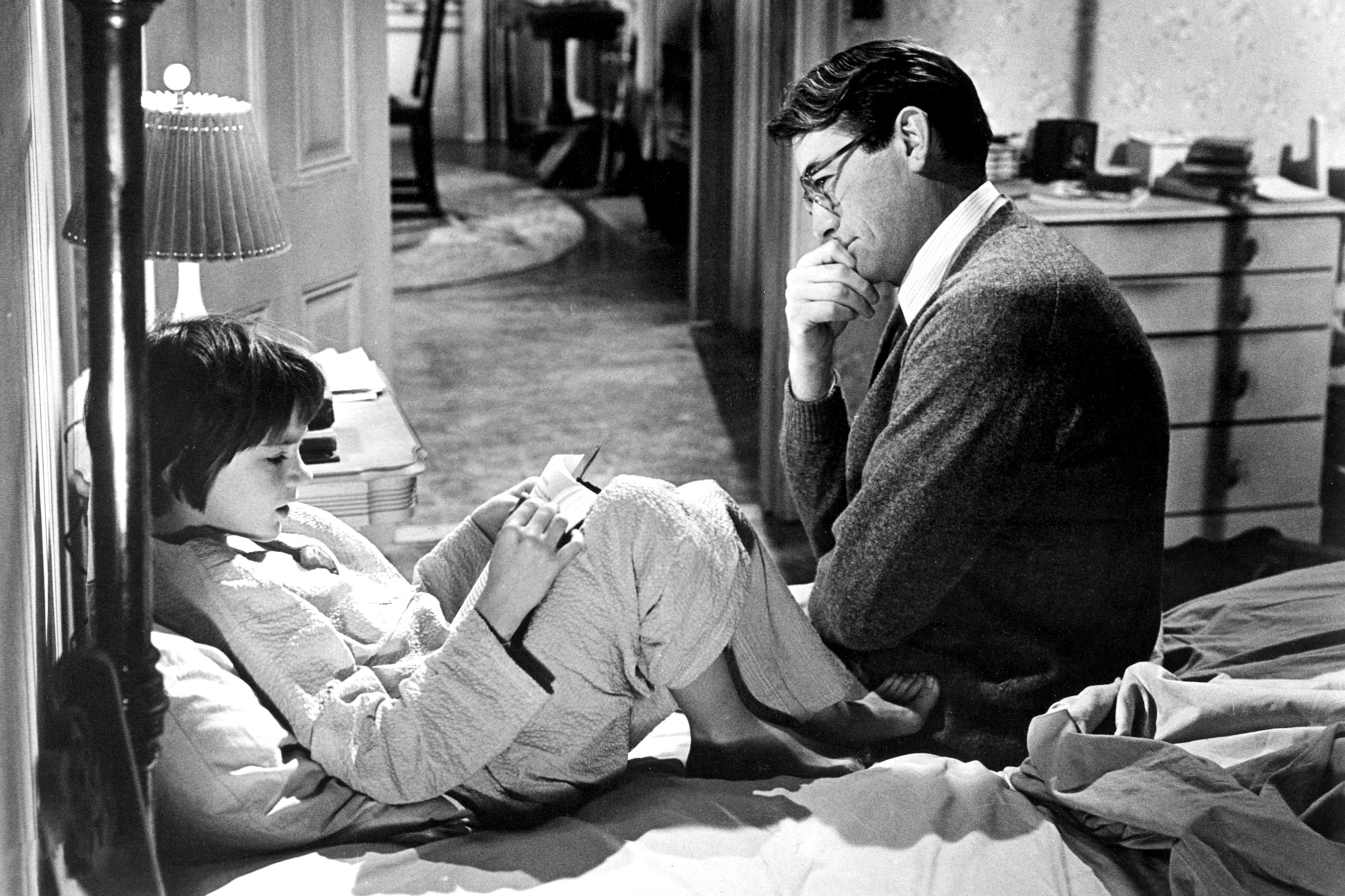 Scout and her dad Atticus Finch in <em>To Kill A Mockingbird</em>