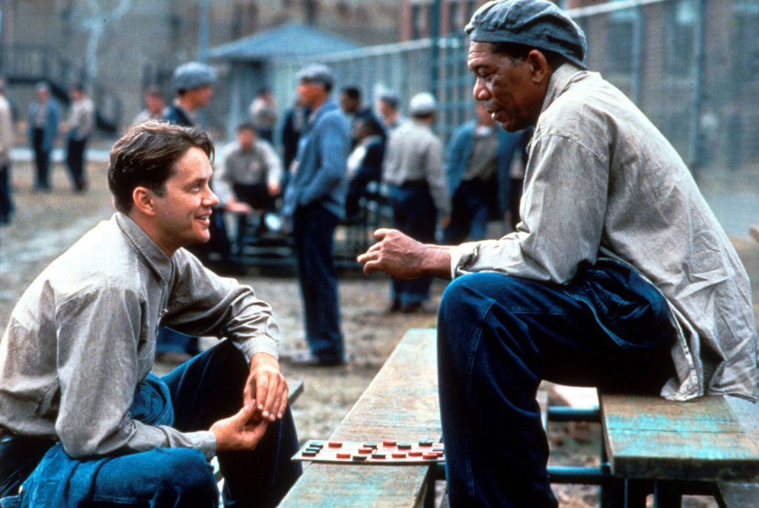 Andy (Tim Robbins) and Red (Morgan Freeman) in <em>The Shawshank Redemption</em>