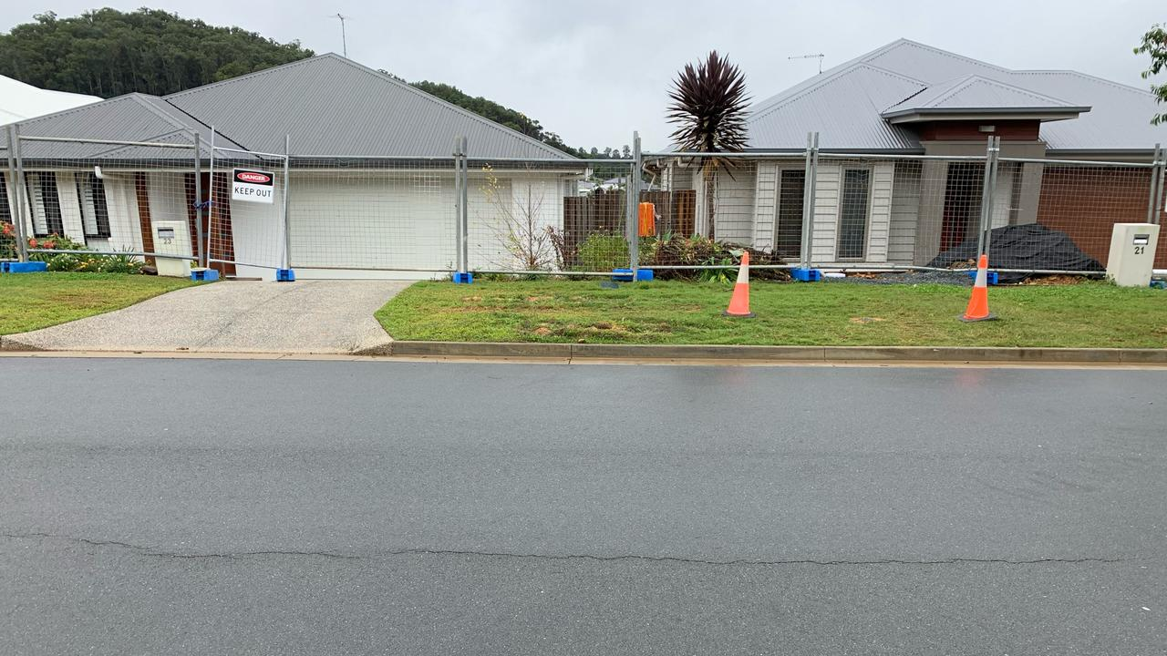 """Fury at developers as homes on Gold Coast street begin """"sliding towards neighbours'"""