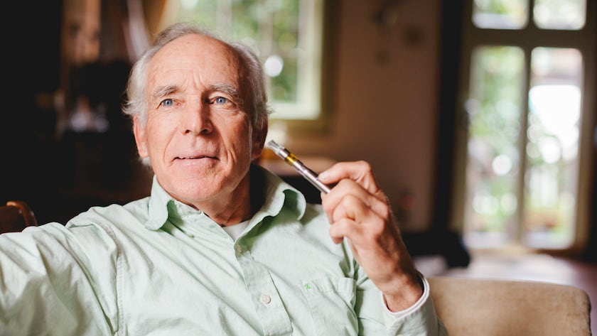Image of an older man vaping marijuana oil.