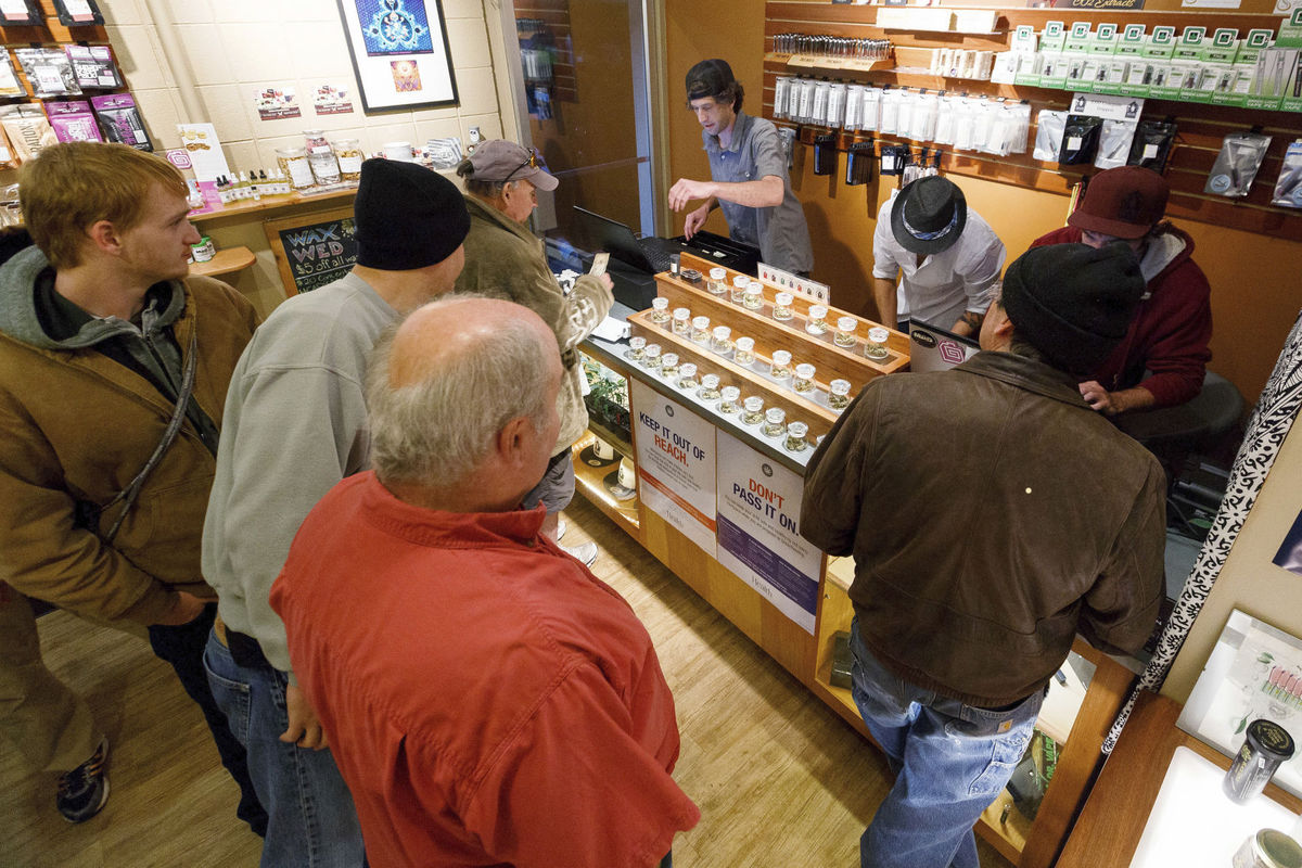 Patrons at Amazon Organics, a marijuana dispensary in Eugene, Oregon.