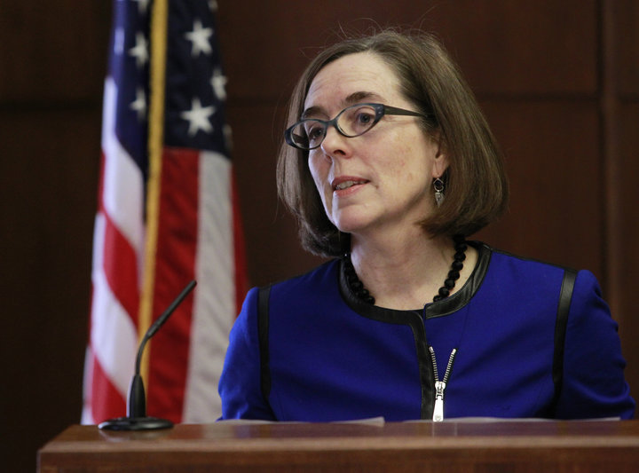Oregon Governor Kate Brown speaking at a podium. But in the event of such intervention, Oregon legislators hope to protect the personal information of marijuana consumers.