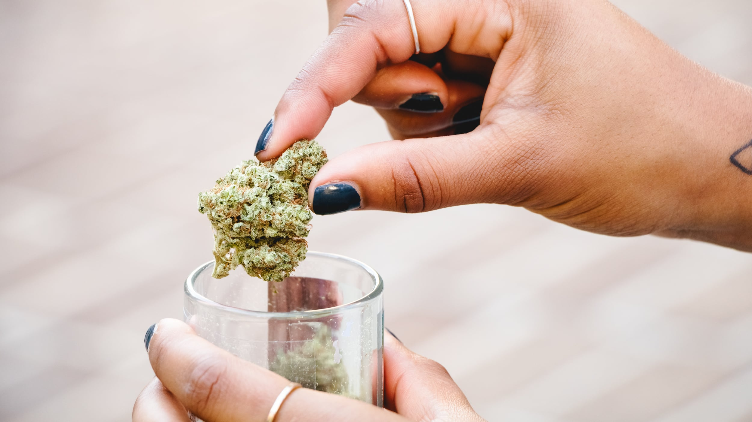 marijuana nugget being lifted from its container