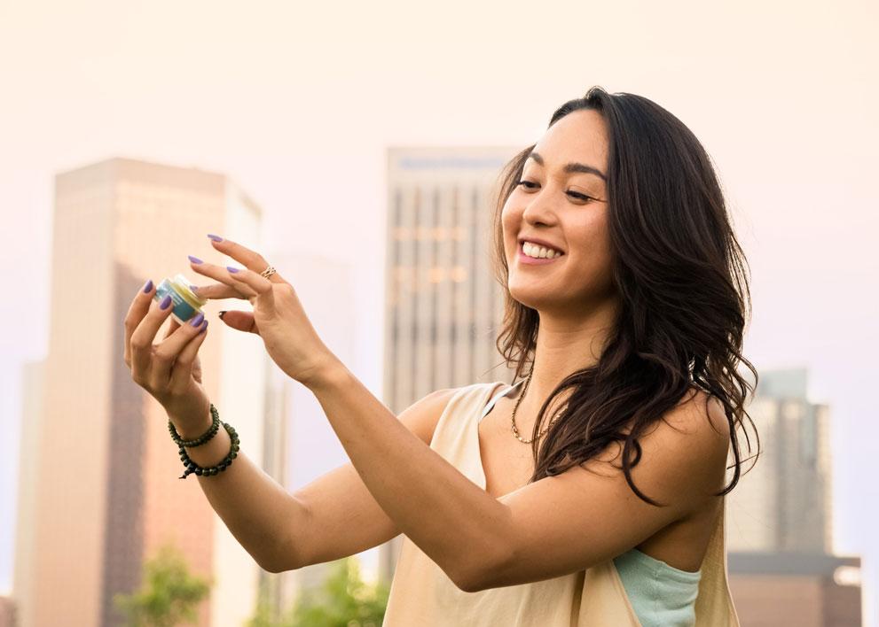 Woman applying a marijuana topical