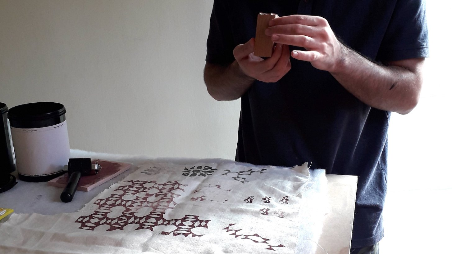I am working on creating new geometric designs using wood stamping blocks.