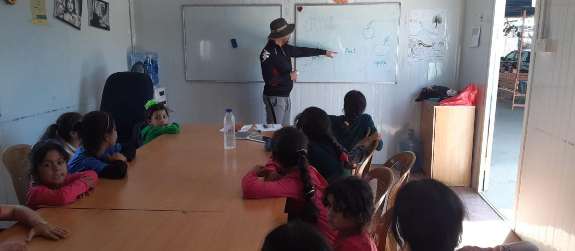 Teaching children during a volunteering activity