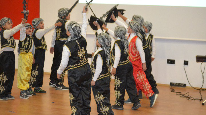 Syrian Children in folkloric costumes rehearsing for the play