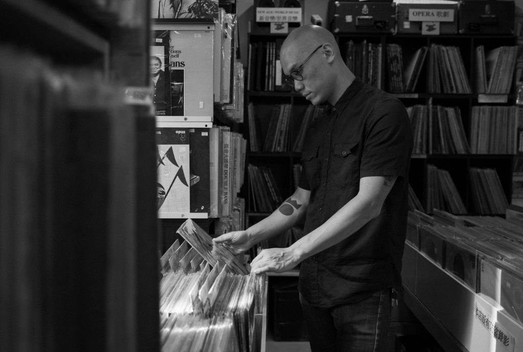 Mr. Ho looking at records