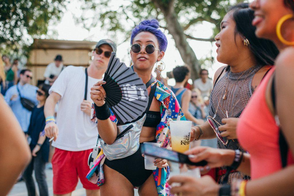 Shi Fu Miz Music Festival Female festivalgoer with purple hair dances