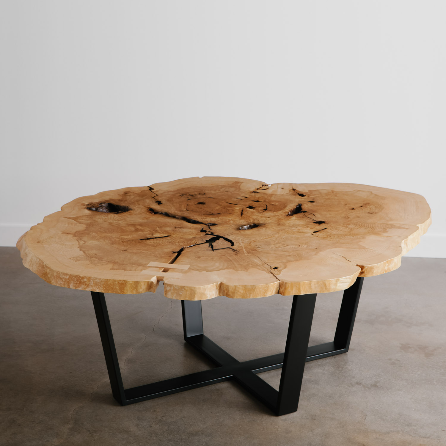 Large round live edge ash table with natural tree characteristics