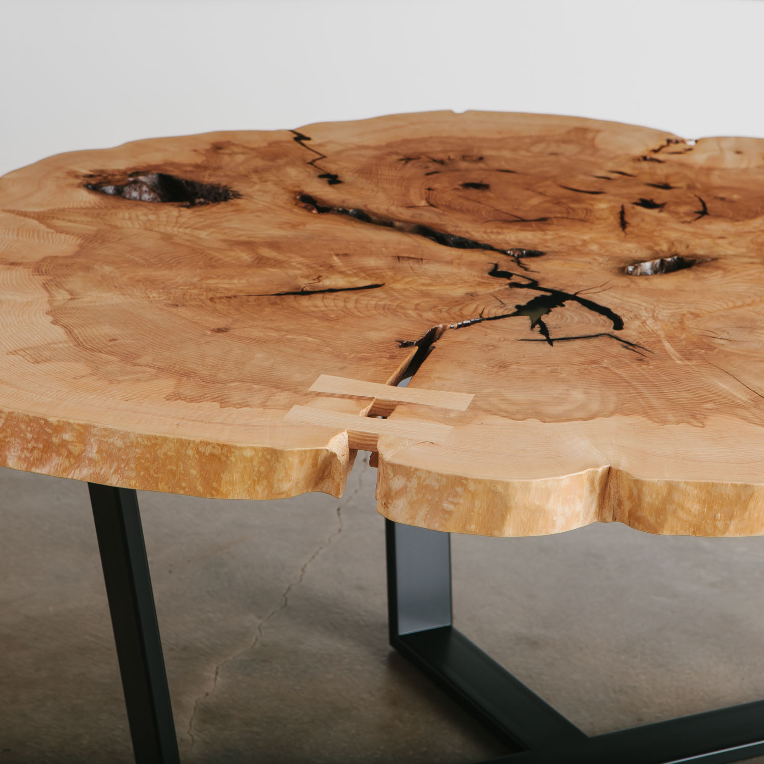 Live edge cross cut ash dining table with natural tree elements