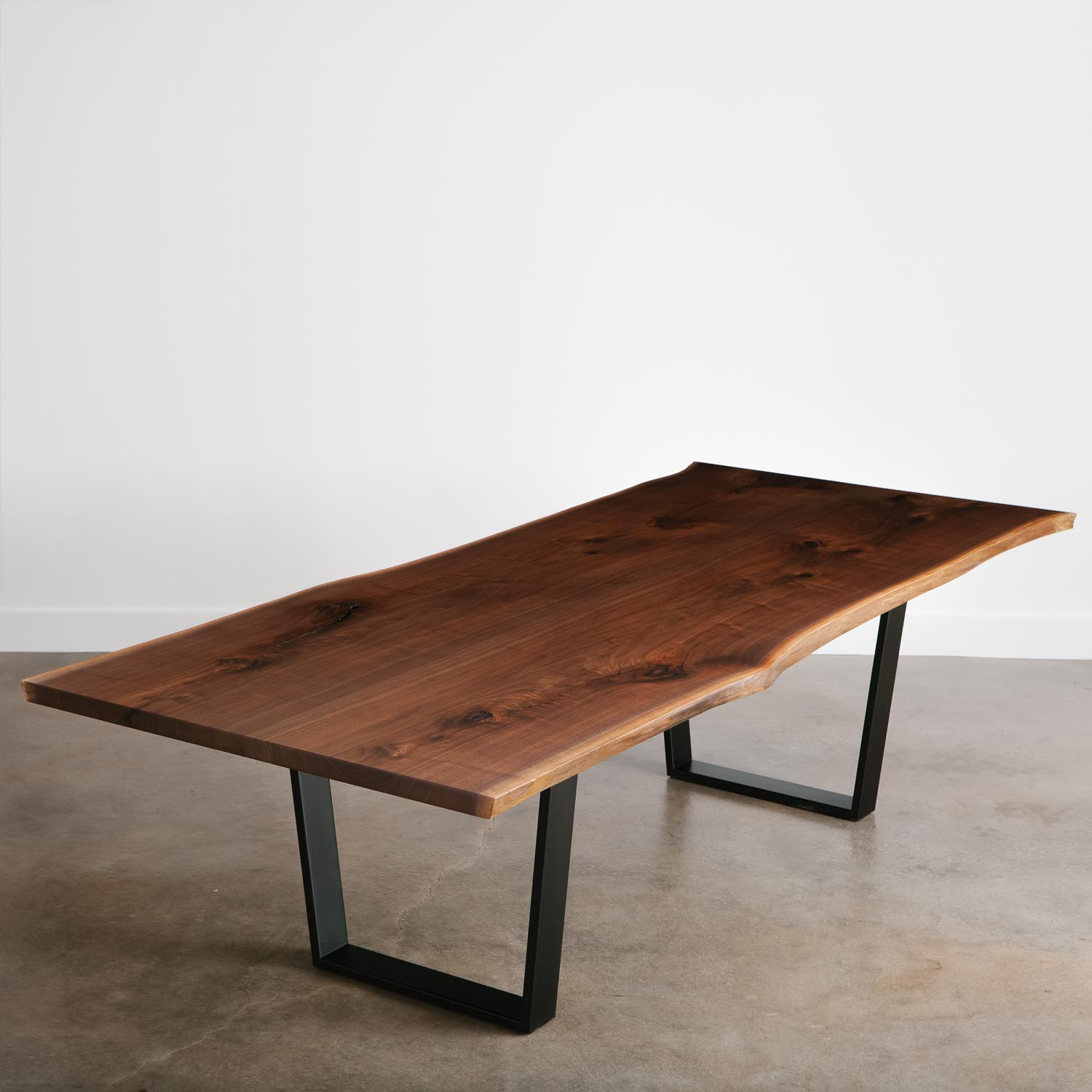 Live edge walnut conference table with black base