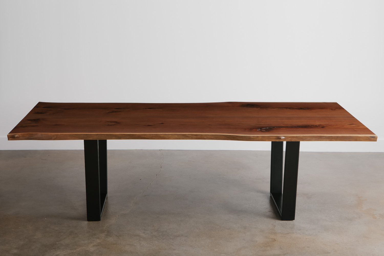 Custom walnut live edge table with natural tree parts